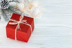 Christmas tree branch with light garland, and red gift box on wh Royalty Free Stock Photos