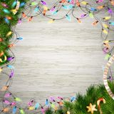 Christmas tree branch with lights. EPS 10 Stock Photos