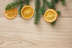 Christmas tree branch on oak table Royalty Free Stock Photography