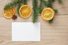 Christmas tree branch on oak table Stock Image