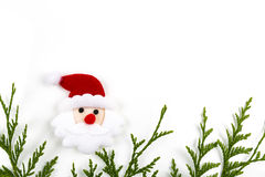 Christmas tree branch and red ball with Santa Claus Stock Images