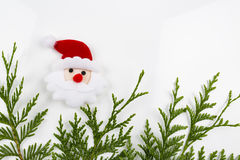 Christmas tree branch and red ball with Santa Claus Royalty Free Stock Photo