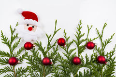 Christmas tree branch and red ball with Santa Claus Stock Photo