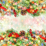 Christmas tree branch with red berries and bokeh lights Royalty Free Stock Photo