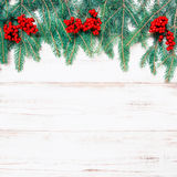 Christmas tree branch with red berries. Holidays decoration retr Royalty Free Stock Photography