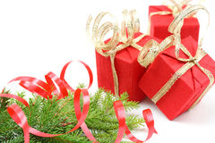 Christmas tree branch and red gift boxes Stock Photo