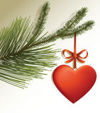 Christmas tree branch with red heart Stock Images