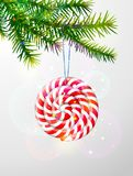 Christmas tree branch with round candy Royalty Free Stock Images