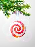 Christmas tree branch with round candy Stock Image
