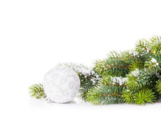 Christmas tree branch with snow and bauble Stock Photography