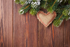 Christmas tree branch with snow and heart toy Royalty Free Stock Image