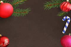 Christmas tree branch with stick, pink and red wavy dull ball on a dark background Stock Photo