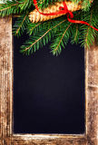 Christmas  Tree Branch on  Vintage Blackboard with cone and red Stock Photography
