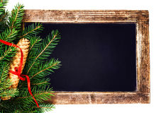 Christmas  Tree Branch on  Vintage Blackboard with cone and red Stock Photos