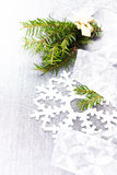 Christmas tree branch and White Christmas decorations on soft gr Stock Image