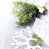Christmas tree branch and White Christmas decorations on soft gr Stock Photos
