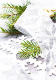 Christmas tree branch and White Christmas ornaments on soft grey Stock Photos