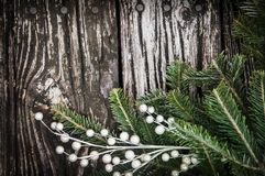 Christmas Tree branch on wood Stock Photo