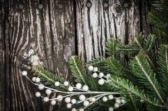 Christmas Tree branch on vintage wood stock photo