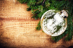 Christmas  Tree Branch on wooden background with festive glass b Royalty Free Stock Images