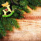 Christmas Tree Branch on wooden background with wood deer and co Stock Images