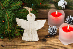 Christmas tree branches with angel on a wooden board Royalty Free Stock Photography