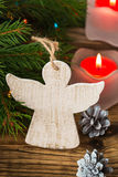 Christmas tree branches with angel on a wooden board Stock Photography