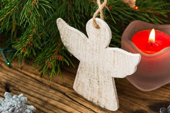 Christmas tree branches with angel on a wooden board. Christmas background. Christmas tree branches with angel on a wooden board Stock Photo