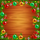 Christmas tree branches around the wood background Stock Image