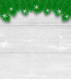 Christmas tree branches background on light boards. Stock Image