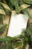 Christmas tree branches with blank paper card stock photos