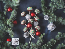 Christmas tree branches with cake pops and baubles Stock Photography