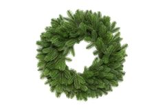 Christmas tree branches in a circle frame with space for text. Round wreath is of fir.  stock images