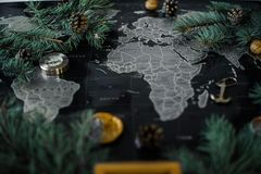 Christmas tree branches and compass on a black map stock photos