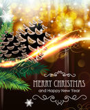 Christmas tree branches with cones. Fir branches and cones on  sparkling Christmas background Royalty Free Stock Image