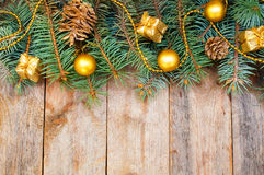 Christmas tree branches with cones, gifts and toys on a white ba Royalty Free Stock Images