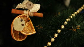 Christmas tree branches with cute handmade natural decoration stock video footage
