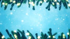 Christmas tree branches decorated with light bulbs. Falling snowflakes stock video