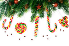 Christmas tree branches. With decoration and candy stock images