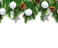 Christmas tree branches with decoration isolated on white background. stock images