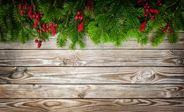 Christmas tree branches decoration red berries vintage wooden ba Royalty Free Stock Photos