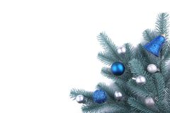 Christmas tree branches with christmas decoration on a white background royalty free stock photography