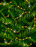 Christmas tree branches and decorative beads. Royalty Free Stock Image