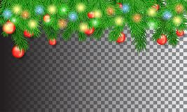 Christmas tree branches with a garland and balls Stock Images