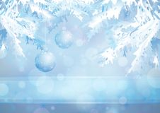 Christmas tree branches and glass balls on the blu. Christmas tree branches and glass balls on the Merry Christmas and Happy New Year blue background with blur Royalty Free Stock Photos
