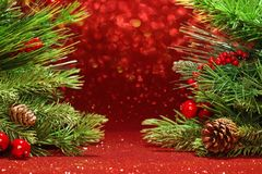 Christmas tree on glittering red background Stock Images