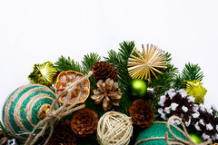 Christmas tree branches with handmade ornaments and pine cones Royalty Free Stock Photo