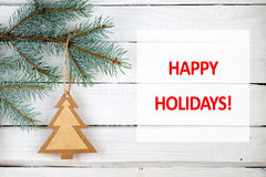 Christmas tree branches and happy holidays text Stock Image