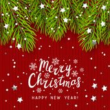 Christmas tree branches on knitted background Stock Images