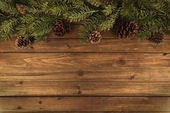 Christmas tree branches on natural wooden table in background. royalty free stock photos